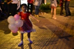 A girl twirls with balloons on Christmas Eve.