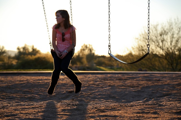 "Avery waits on the swings for a boy to meet her at Stetson Hills Park on Dec. 17. ""Turns out he's not coming,"" she said before she walked back home."