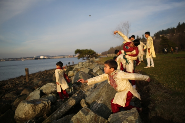 Paranav Singh throws rocks into the bay on Saturday, Feb. 1 at Boulevard Park. He was part of a traditional Indian wedding party taking pictures at the park.