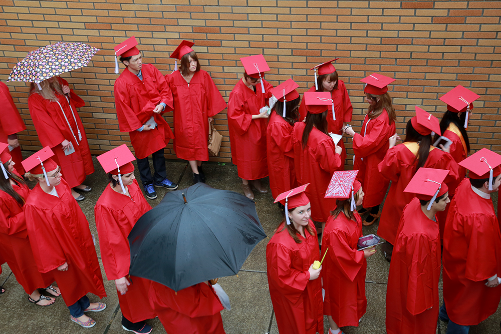 Graduated wait in a gentle rain to make an entrance into their graduation ceremony. More than 700 students ranging in age from 17 to 65 graduated from Skagit Valley College on June 20, 2013.