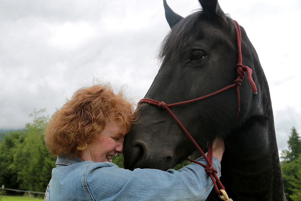 "Cassie Freer hugs Gemma on June 22, 2013 at the Skagit Backcountry Horsemen's Round-Up-Ride at Fire Mountain Trail Course. ""She's my favorite horse of all times. She's gentle, she's smart, she's loving,"" Freer said."