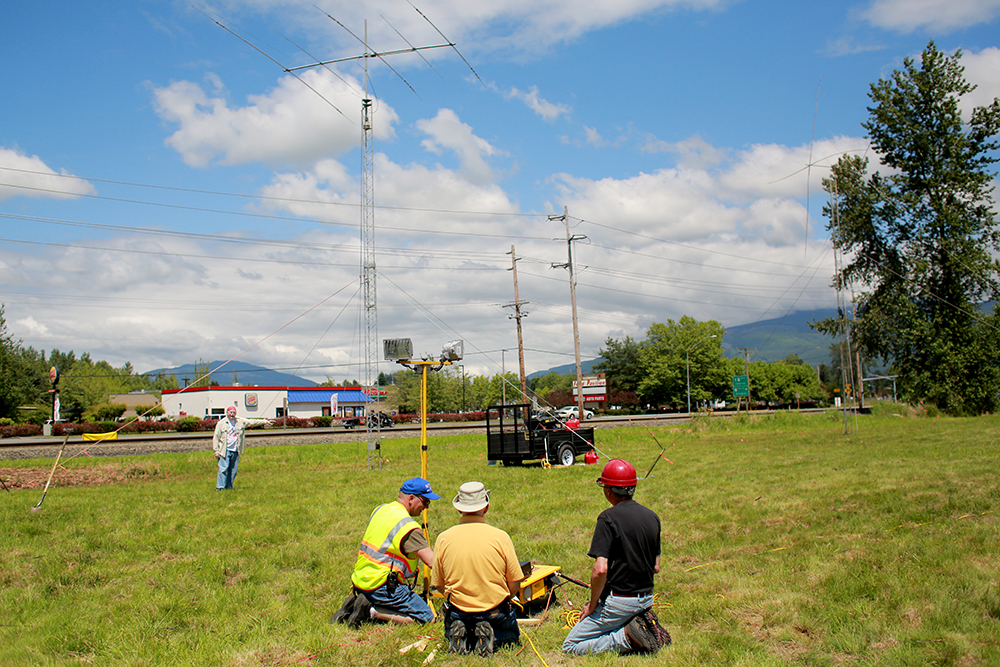 "(From left) Brian Green, Bill Johnson and Bob Cummings connect control wires to make antennas operate at the national Radio Field Day on June 22, 2013. The Radio Amateurs of Skagit County participated in a ""field day"" where HAM radio fanatics try to contact as many people as possible within 24 hours."