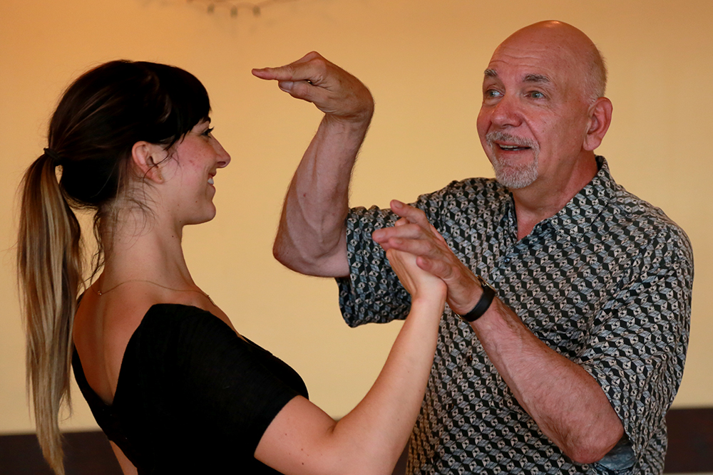 Tango instructor David Imburgia demonstrates how light the follow is by pushing his partner, Krissa Mickelwait, over with the tip of his finger. Imburgia teaches and dances tango in Skagit and Whatcom county through his company Tango Popolare. Brooke Warren / Skagit Valley Herald
