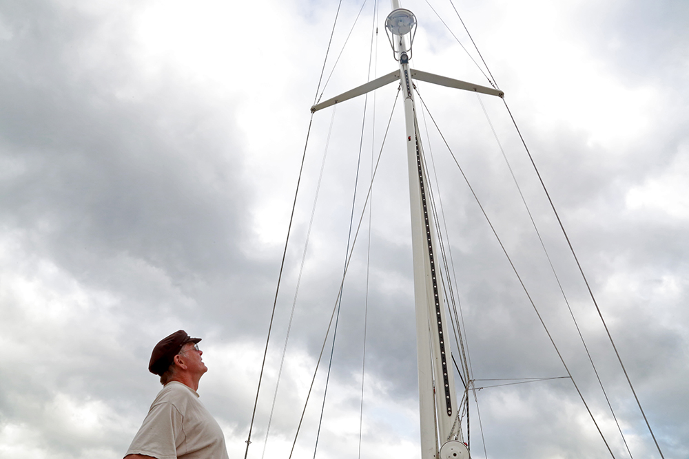 Jeff Frost gazes up at the 72-foot mast of his 60-foot sailboat IsolaBella. He was spending a week in Anacortes, Wash. to get his marine toilets fixed before he continued his trip from Olympia, Wash. to Desolation Sound in B.C. Brooke Warren / Skagit Valley Herald