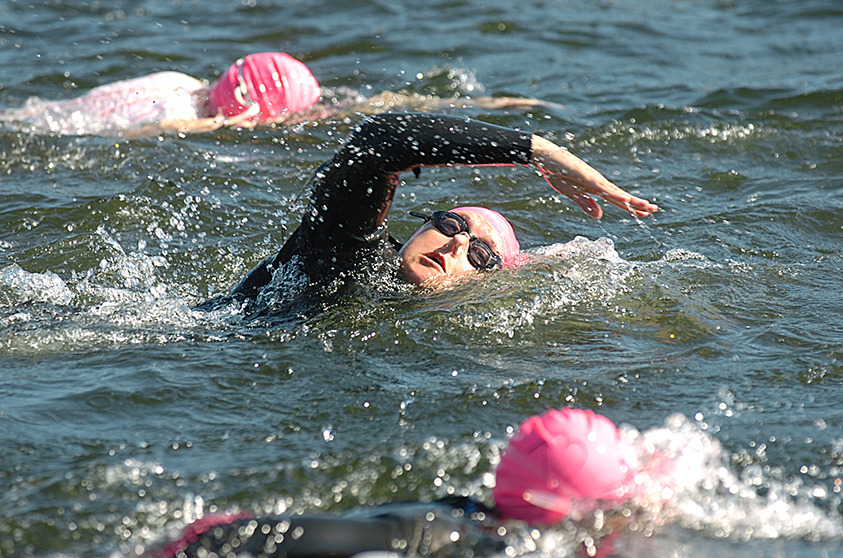A triathlon racer starts the swimming leg of the Clear lake Triathlon on July 13, 2013.  Brook Warren / Skagit Valley Herald