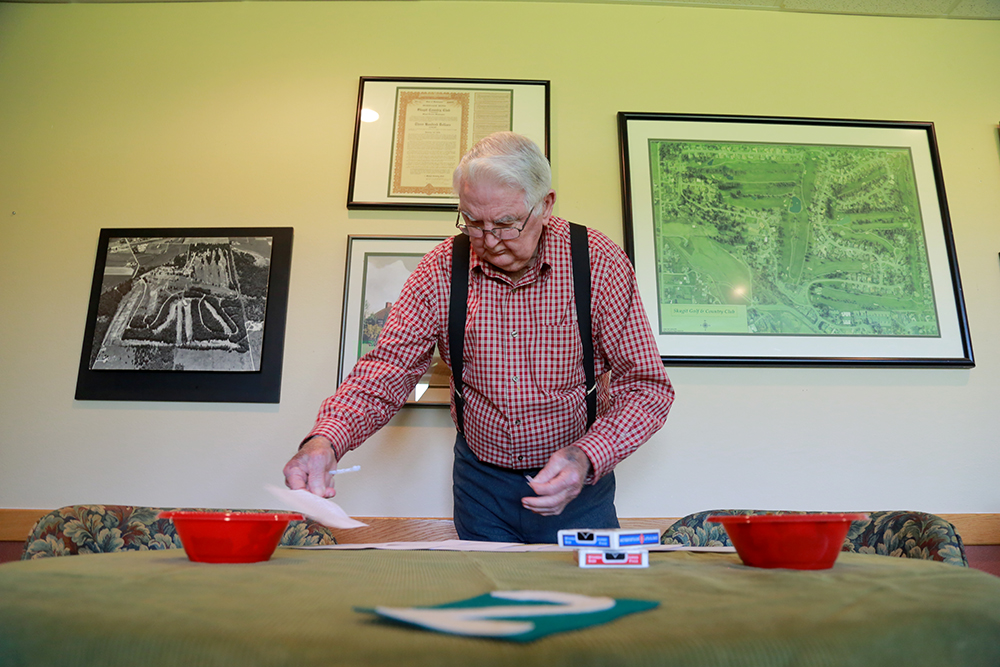 "Orville ""Bud"" Winslow, 91, sets up bridge for his friend Don Johnson's 90th birthday on July 18, 2013. They have been playing as a club  since 1955. Brooke Warren / Skagit Valley Herald"