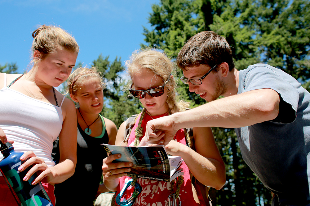 Kelly DiStefano, Dylan Bradley, Lauren Lepage and Mike DiStefano check out the new Mt. Erie Climbing Guidebook after climbing at Mt. Erie on July 24, 2013.  Brooke Warren / Skagit Valley Herald
