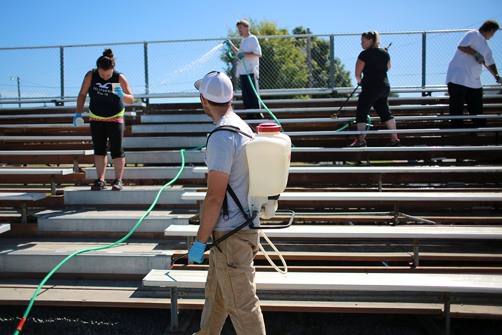 Jacob Phipps, a Skagit County Parks employee, supervises participants in the One Day Offender program while they bleach and each the bleachers at the Skagit County Fairgrounds in Mount Vernon, Wash. The program is conducted by the Skagit County Sheriff's Office as an alternative to jail for people with minor offenses.  Brooke Warren / Skagit Valley Herald