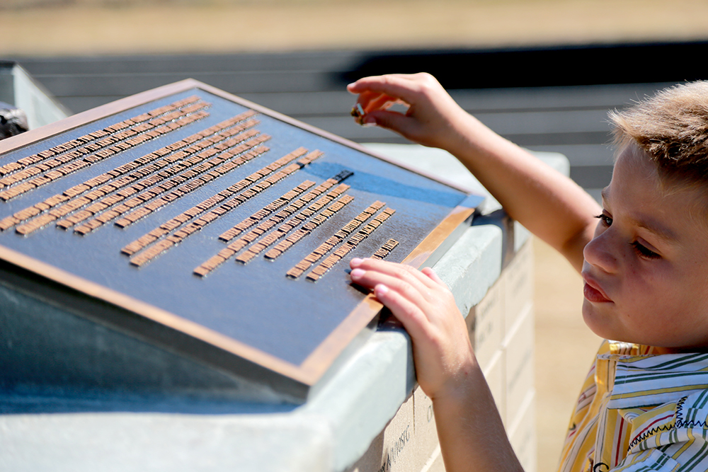 Aiden Vose, 6, studies the plaque at the base of his father's statue on July 27, 2013 in Concrete, Wash. Douglas Vose III was a Green Beret who lost his life in 2009 in Afghanistan. Brooke Warren / Skagit Valley Herald