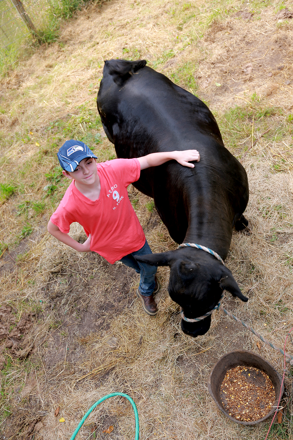 Kyle Brown stands with his steer, Cash, whom he named for the reason why he raised the animal. Brown will show Cash at the Skagit County Fair where he will sell him for about $2 per pound or $4000.  Brooke Warren / Skagit Valley Herald