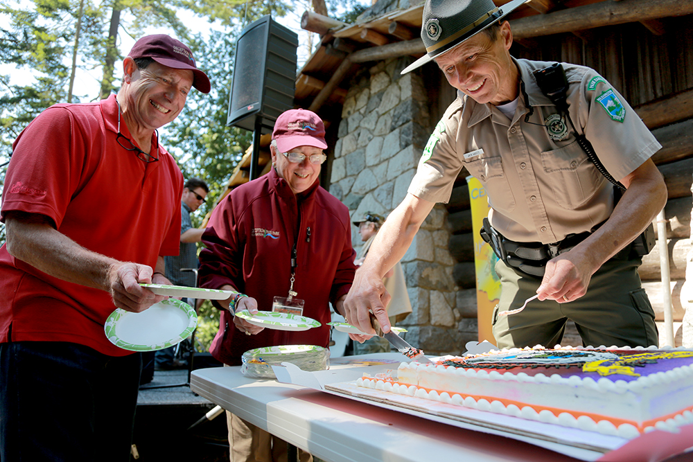 Jack Hartt (right), the park manager at Deception Pass State Park, cuts Washington State Parks' 100th birthday cake while Oak Harbor City Council member Bob Severns and Vice President of Deception Pass Park Foundation wait to hand out plates at Deception Pass State Park on Aug. 3, 2013. The Washington State Parks system was established in March 1913, three years before the National Parks system.  Brooke Warren / Skagit Valley Herald