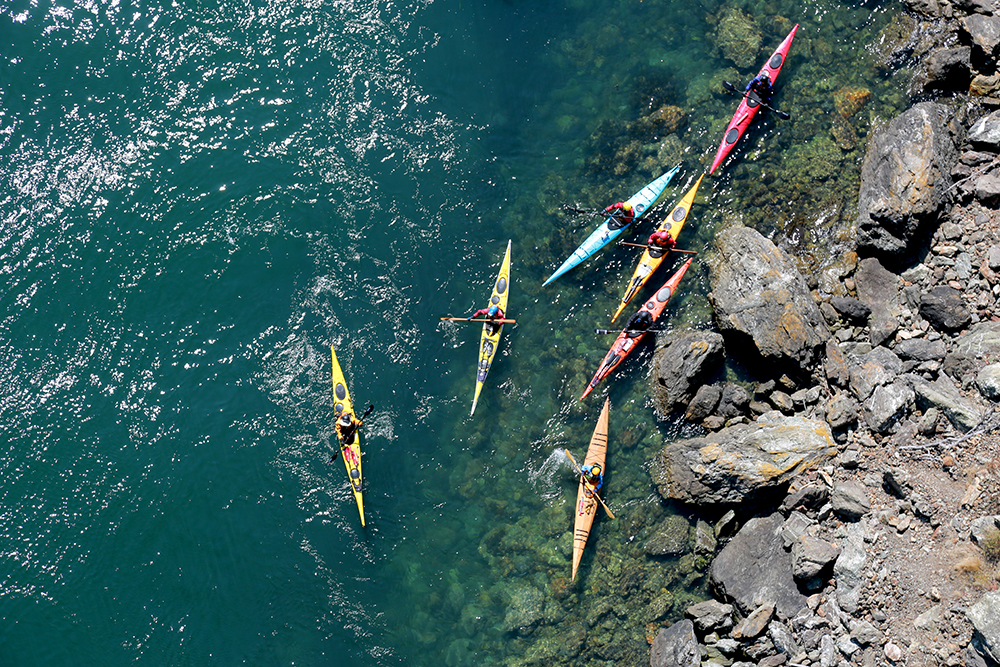 Kayakers float in Deception Pass on Aug. 3, 2013 during the Washington State Parks centennial celebration. Brooke Warren / Skagit Valley Herald