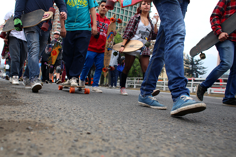 Skaters roll and walk down the street on Sept. 14, 2013 to promote alternative transportation.