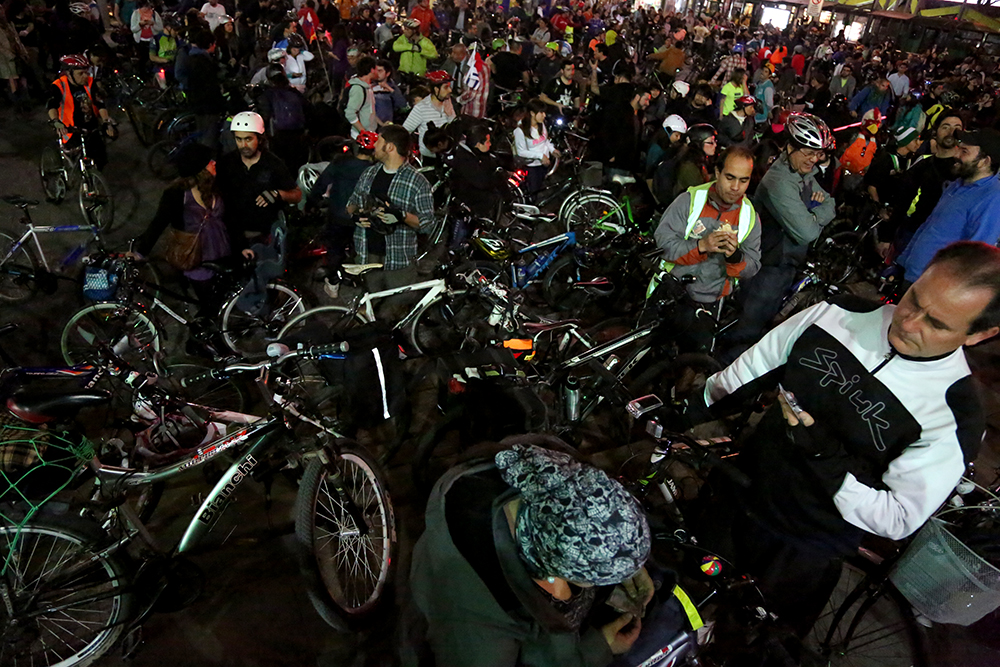 Hundreds of cyclists gather on Sept. 3, 3013 in Plaza Baquedano for a bicycle ride to promote biking as a mode of transportation. More than 6000 people participate in the ride on the first Tuesday of each month.