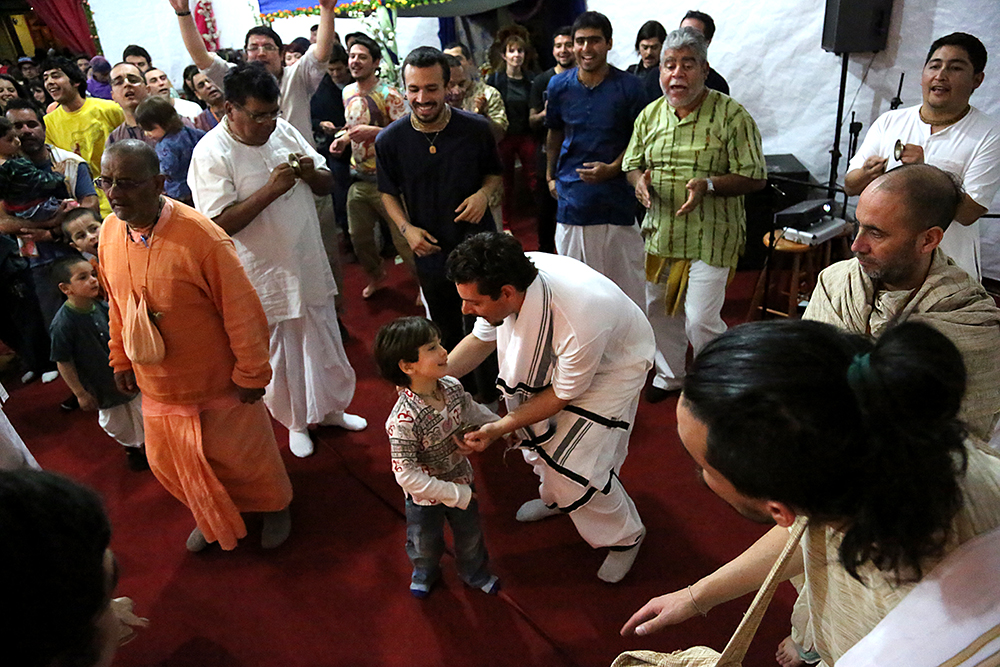 Are Mirochnick tries to get Ian to dance at the Janmastami Festival. Hundreds of people gathered to celebrate the Janmastami Festival that commemorates the birth of the Hindu god Krishna on August 28, 2013 at Hare Krishna Temple in Santiago, Chile.