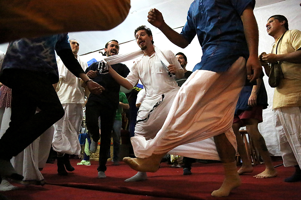 Are Mirochnick (in white) dances with other men at the Janmastami Festival. Hundreds of people gathered to celebrate the Janmastami Festival that commemorates the birth of the Hindu god Krishna on August 28, 2013 at Hare Krishna Temple in Santiago, Chile.