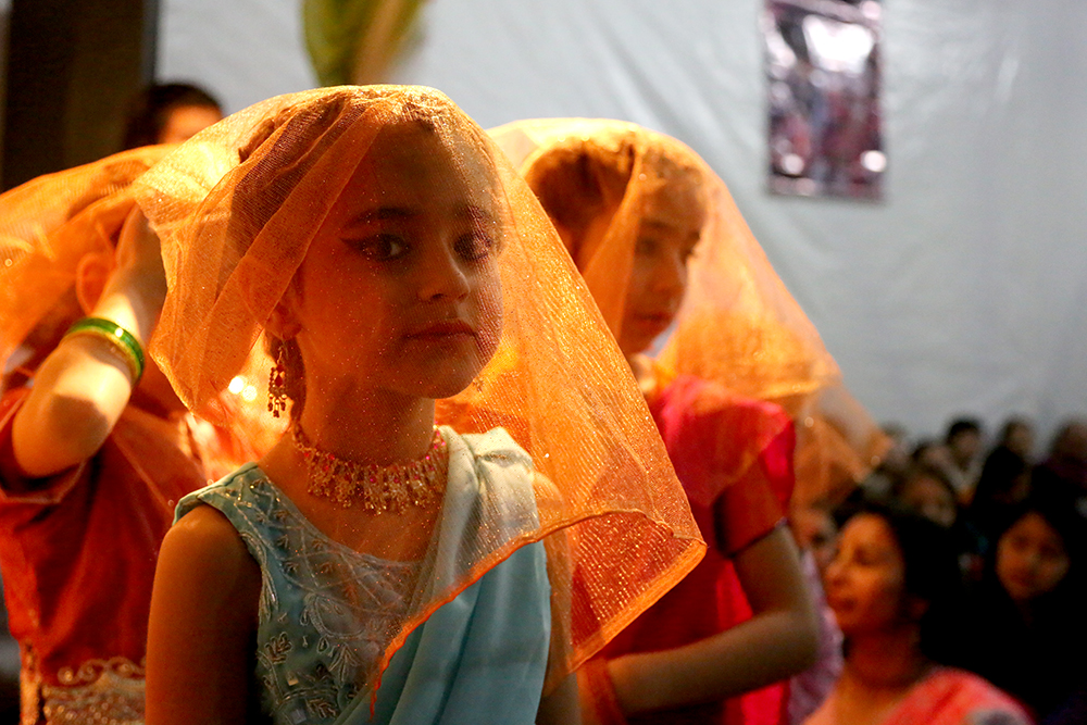 Sachi waits to perform a theater dance with other girls. Hundreds of people gathered to celebrate the Janmastami Festival that commemorates the birth of the Hindu god Krishna on August 28, 2013 at Hare Krishna Temple in Santiago, Chile.
