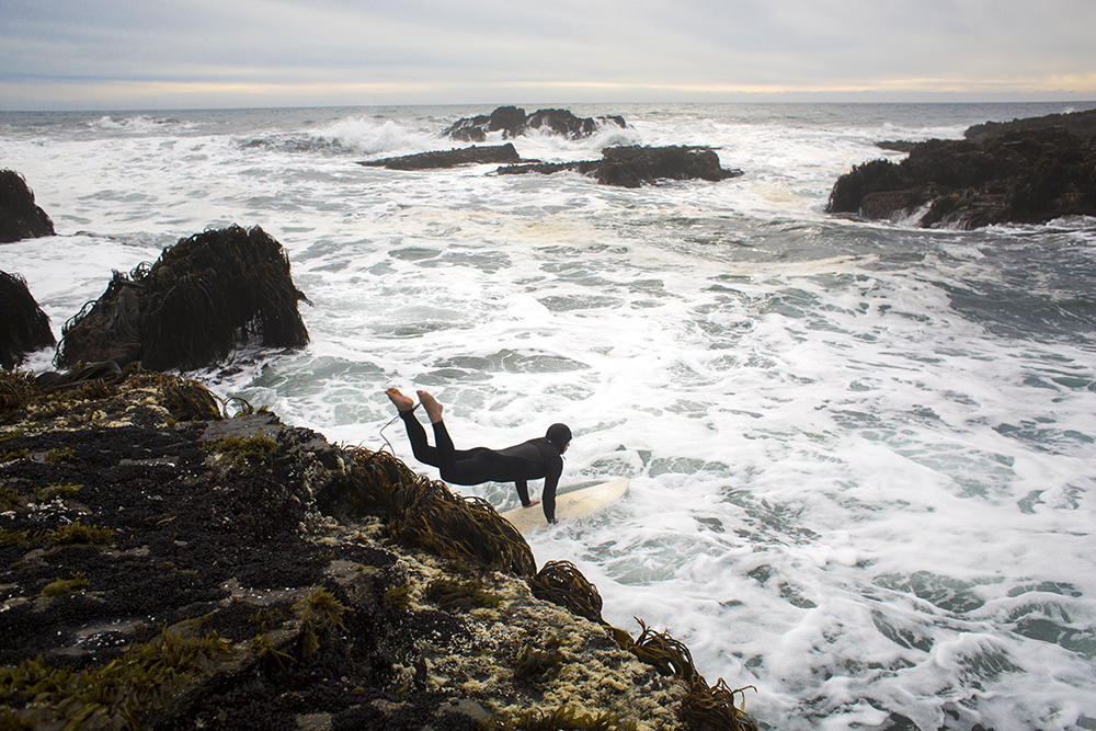 A surfer launches into the ocean at Punta de Lobos near Pichilemu, Chile on Dec. 19, 2013. The beach is one of the best surf locations in South America.
