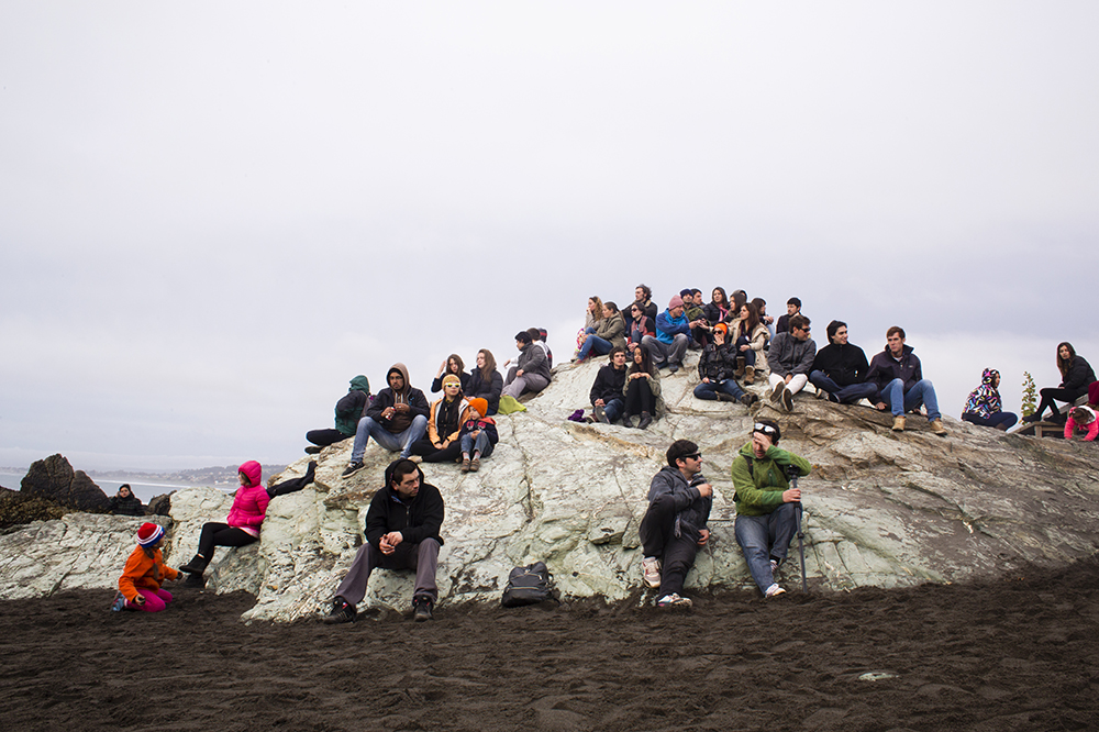 Spectators gather on a rock to watch Surf Beats Best Trick competition at Punta de Lobos near Pichilemu, Chile on Dec. 19, 2013. The beach is one of the best surf locations in South America.