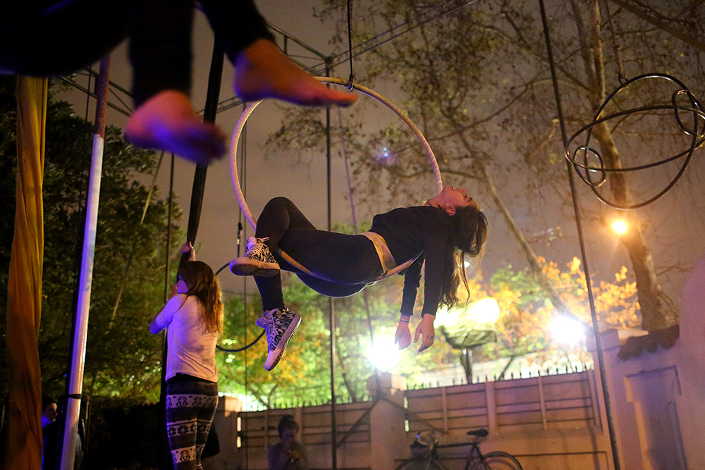 Students in an aerial acrobatics class practice silks and hoops on Oct. 2, 2013 at 7Siete, an aerial arts school, in Santiago, Chile.