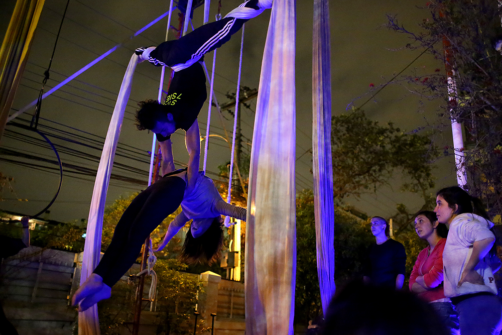 Juan Pablo Vásquez Heap and his partner, Ivana Vargas, practice a duo series on silks on Oct. 2, 2013 at 7Siete, an aerial arts school, in Santiago, Chile.