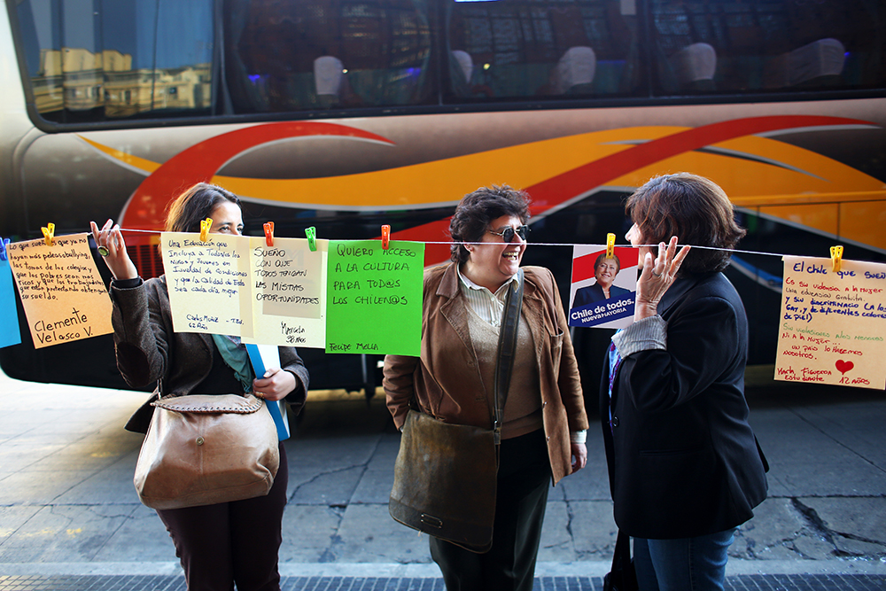Supporters for Michelle Bachelet, the Socialist candidate for Chile's 2013 presidential election,  created a line of wishes for Chile's future outside GAM, Gabriela Mistral Cultural Center, in Santiago on Oct. 3, 2013. They invited anyone walking along the street to add their wishes for Chile.