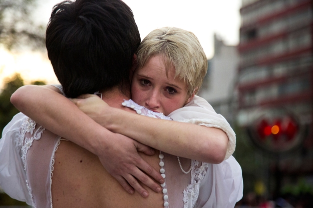 A street performer begins crying as part of a performance in Plaza Italia on Oct. 18, 2013 in Santiago, Chile.