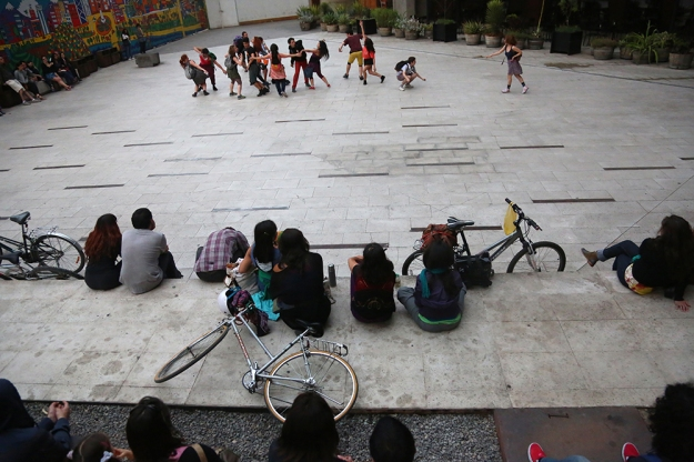 People arrived by bike and on foot to watch a free dance performance at Gabriela Mistral Cultural Center in Santiago, Chile on Oct. 18, 2013.