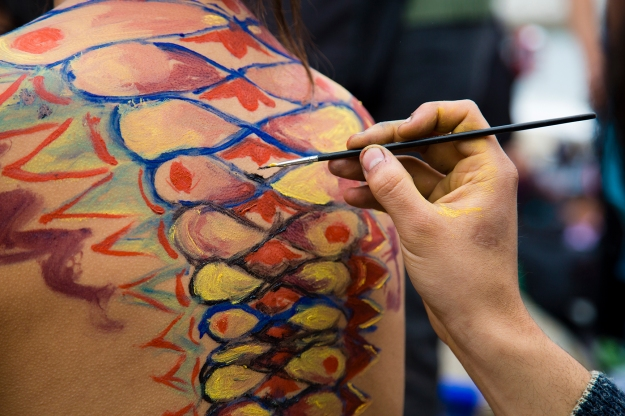 An artists finishes up details on his human canvas at Mil Tambores 2013 in on Oct. 6 in Valparaiso, Chile. The event was an expression of freedom to use public spaces for art and cultural expression.
