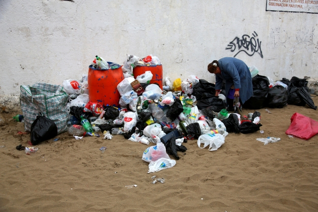A women searches through the trash at Mil Tambores to find salvageable items on Oct. 6, 2013 in Valparaiso, Chile. The time and date of the event was kept secret until a week prior this year to prevent being shut down by authorities due to the excessive amount of trash.
