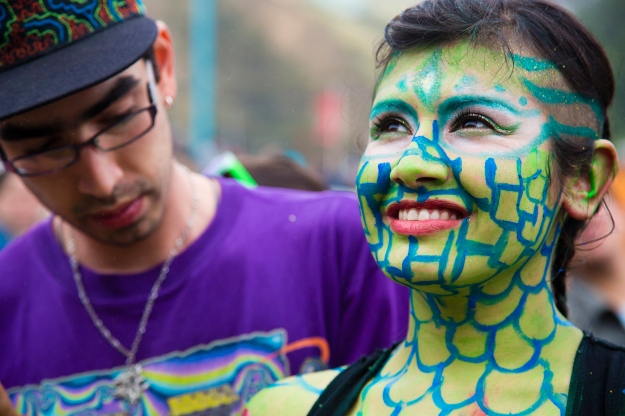 A body painting model waits for her artist to finish his creation at Mil Tambores 2013 in on Oct. 6 in Valparaiso, Chile. The event was an expression of freedom to use public spaces for art and cultural expression.