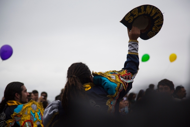 A dancer in Caporales Reales Brillantes throws his hat in the air during the Mil Tambores parade that celebrated keeping public spaces free for artistic and cultural expression on Oct. 6, 2013 in Valparaiso, Chile. The dance group performs Andean and other Latin American dances.
