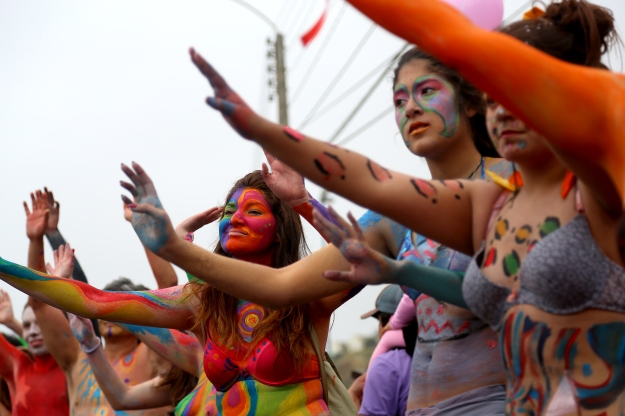 People dealt with cold temperature and clouds to show of f their painted bodies at Mil Tambores 2013 in on Oct. 6 in Valparaiso, Chile. The event was an expression of freedom to use public spaces for art and cultural expression.