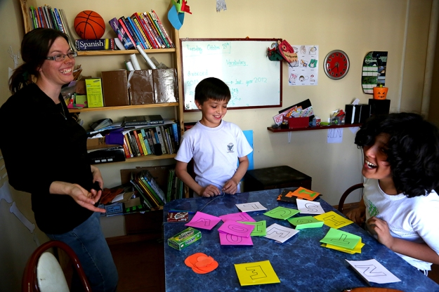 Dora Nuss-Warren helps her English students create Halloween-themed words in small private classes out of her home in Los Antiguos, Argentina on Oct. 31, 2013. Halloween is an important holiday for English students because it is not a celebrated holiday in Argentina.