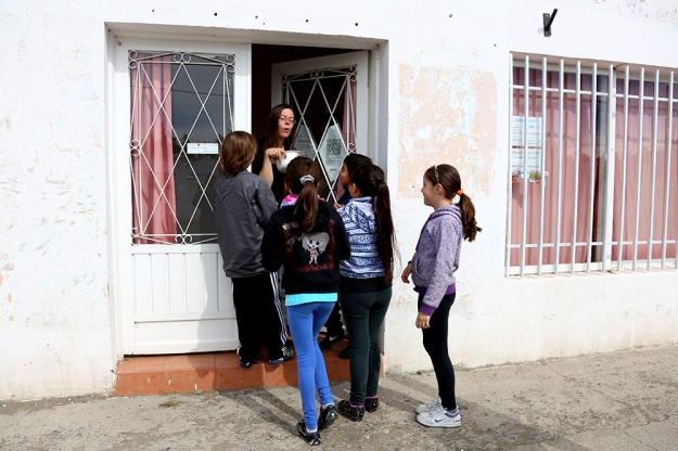 Dora Nuss-Warren hands out treats to her English students as they practice Trick-or-treating during class on Oct. 31, 2013. Halloween is an important holiday for English students because it is not a celebrated holiday in Argentina.