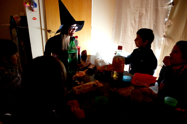 Dora Nuss-Warren tells a scary story during an English class at her home in Los Antiguos, Argentina on Oct. 31, 2013. Halloween is an important holiday for English students because it is not a celebrated holiday in Argentina.