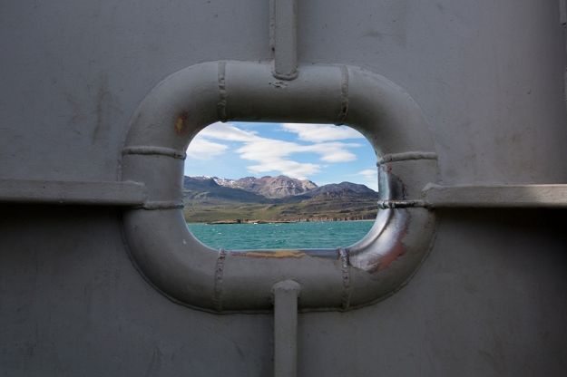 Cerro Piramide shows through a porthole on a daily ferry takes cars and passengers across Lago General Carrera on Nov. 1, 2013.