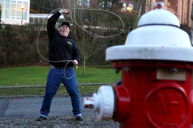 Forrest Hicks, 18, practices roping a fire hydrant outside of Nash Hall at Western Washington University on Jan. 15, 2013.