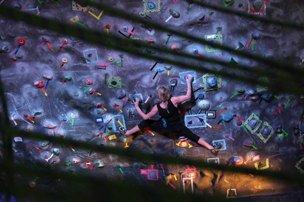 Morgan Cabe, 20, pulls through a move in the women's open finals at the NC3 Bouldering Competition at Western Washington University on Feb. 1, 2014.