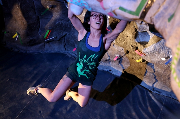 Liza Dinh, 20, swings from the cave at the NC3 Bouldering Competition at Western Washington University on Feb. 1, 2014.