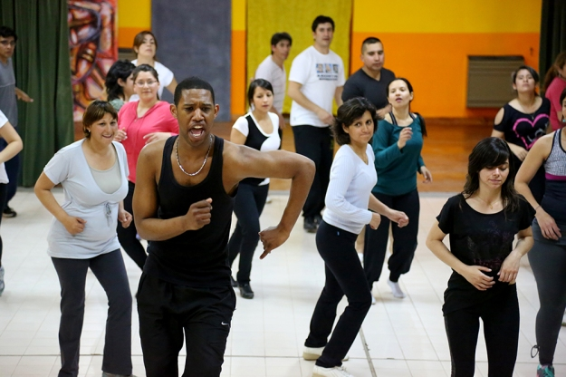 Edgar Arias Agüero, from the Dominican Republic, teaches free latin dance classes on Wednesday nights in Los Antiguos, Argentina. The dance classes are one of the activities that brings neighbors from the small town of 5,000 people together.