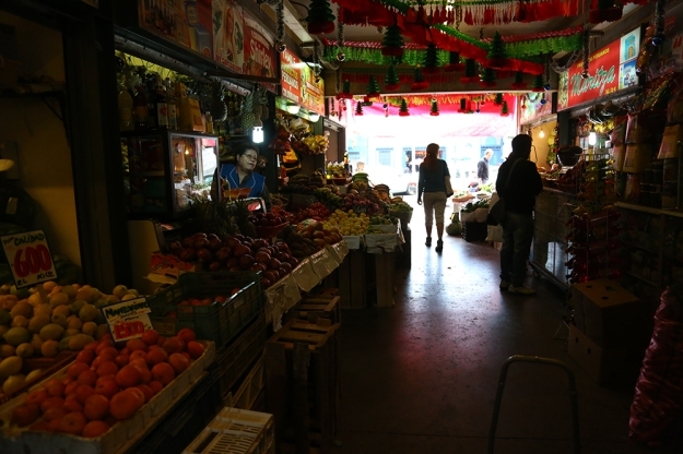 Katherine Darrow, a tourist from the United States, explores the traditional markets in Santiago, Chile.