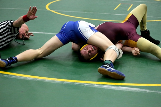 Sedro-Woolley's Clayton Johnson pins Cedarcrest's Ely Malametz at the boys 2A regional wrestling tournament on Feb. 15, 2014, at Squalicum High School in Bellingham, Wash.