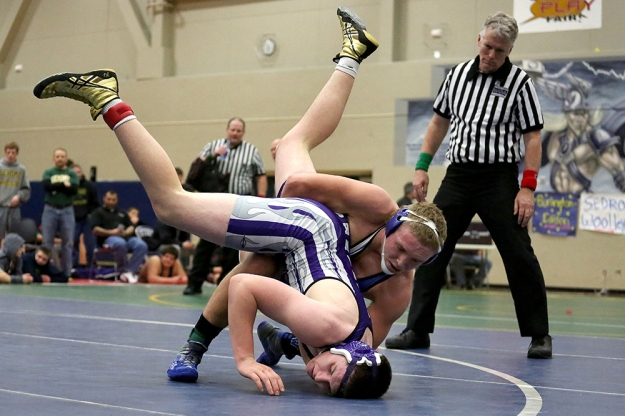Sedro-Woolley's Gabe Torgerson has the advantage against Anacortes' Ross Atterberry. High School wrestlers competed in the boys 2A regional wrestling tournament on Feb. 15, 2014, at Squalicum High School in Bellingham, Wash.
