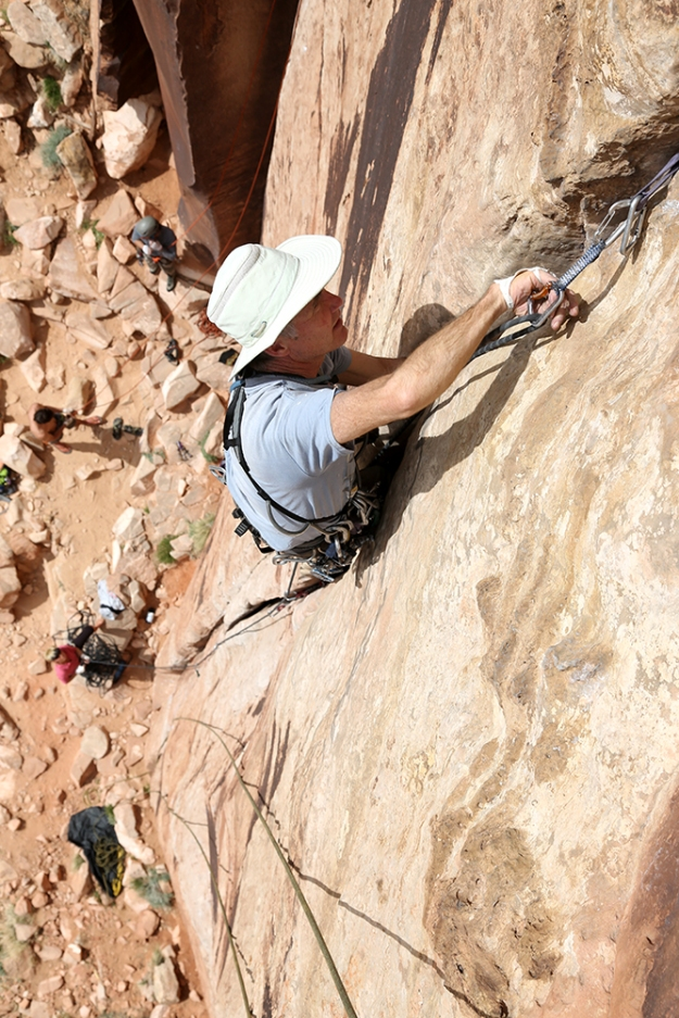 "Robert Warren climbs ""Elephant Man"" (5.10-) as a warmup on his arrival for a week-long climbing trip in Indian Creek, Utah on March 21, 2014."