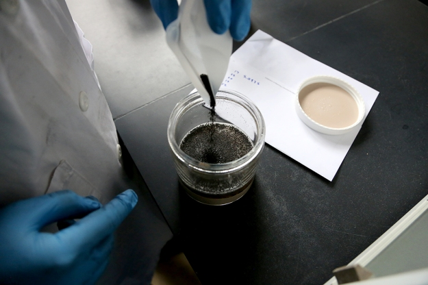 After initial samples of PCB toxicity are tested, Cabiyo mixes activated carbon into the sediment samples. They will wait a few weeks until the samples are thoroughly mixed before measuring how each environmental factor affects the ability of activated carbon to reduce availability of PCBs in the sediment.