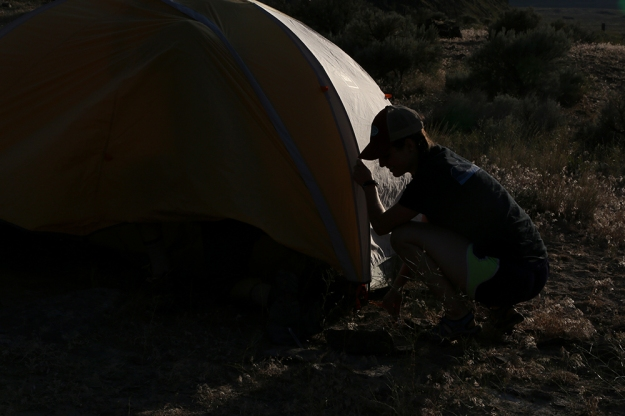 Ari Blatt sets up her tent in the dying light.