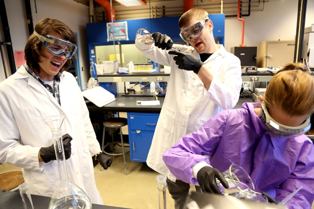 (From left) Thomas Craig, Bodie Cabiyo and Shannon Daughtrey sing in the lab while preparing environmental factors to test their effect on activated carbon's ability to capture polychlorinated biphenyls (PCBs) in sediment, the soil under lakes, rivers and oceans. PCBs are toxic organic chemicals and even a tiny amount in the environment are harmful to living organisms and stay in the environment for a long time. Activated carbon is a new treatment that can reduce the availability of PCBs in the environment.