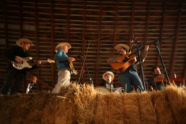 Cahalen Morrison & Country Hammer perform on top of a haystack in Paonia, Colo.