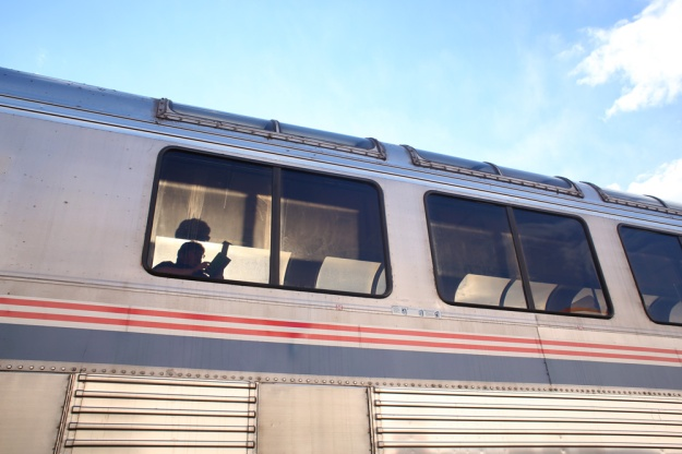 A passenger reads in an Amtrak train at the Grand Junction station on Feb. 15, 2015.